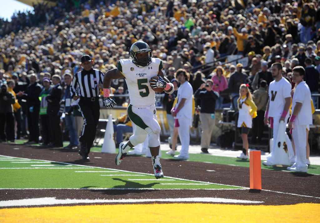 . Colorado State RB, Kapri Bibbs, all alone, scores a touchdown in the fourth quarter against Wyoming at Jonah Field at War Memorial Stadium Saturday, October 19, 2013. The Rams won 52-22.  (Photo By Andy Cross/The Denver Post)