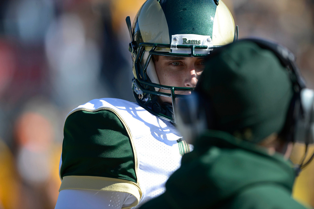 . Colorado State QB, Garrett Grayson, talks with an assistant coach along the sidelines during a timeout during the game against Wyoming at Jonah Field at War Memorial Stadium Saturday, October 19, 2013.  (Photo By Andy Cross/The Denver Post)