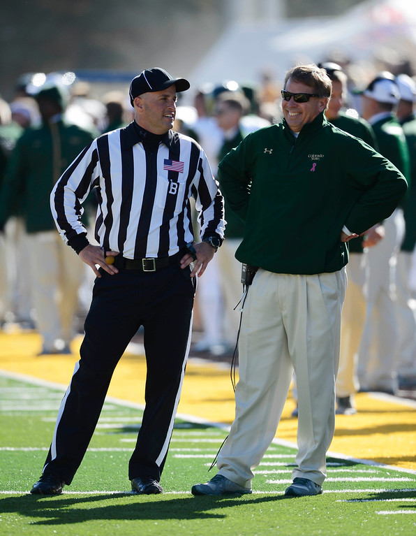 . Colorado State head football coach, Jim McElwain, has a a laugh with a back-judge during the game against Wyoming at Jonah Field at War Memorial Stadium Saturday, October 19, 2013. (Photo By Andy Cross/The Denver Post)