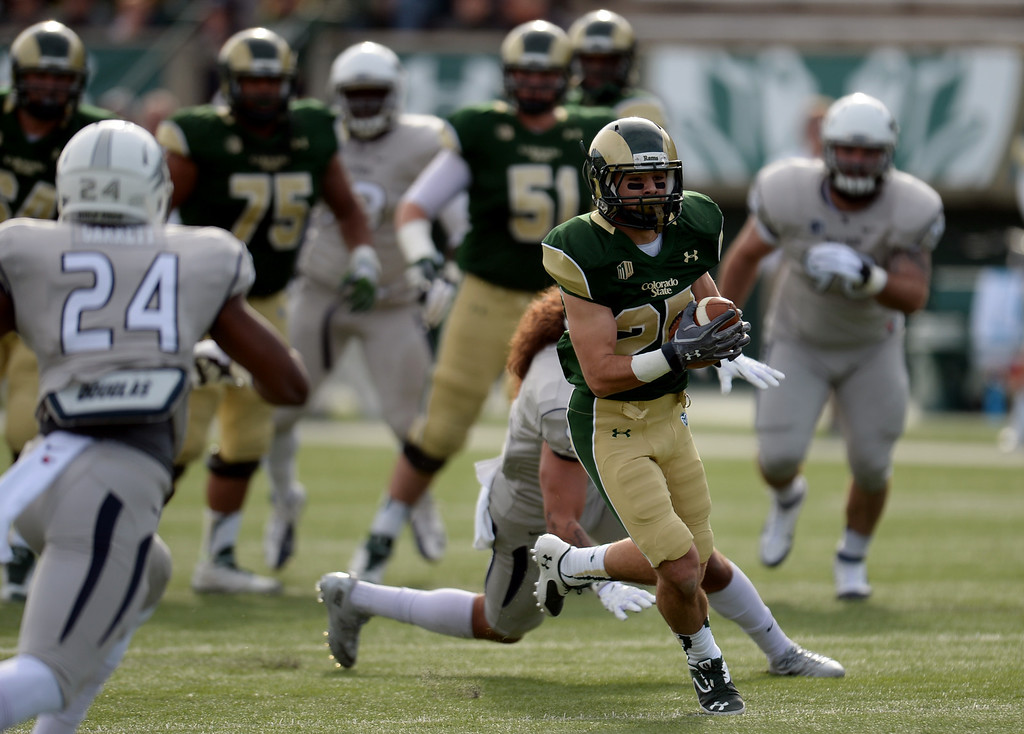 . Joe Hansley of Colorado State University (25) completes the pass from QB Garrett Grayson (18) in the 1st half of the game against University of Nevada at Hughes Stadium in Fort Collins, Colorado on November 09, 2013. CSU won 38-17. (Photo by Hyoung Chang/The Denver Post)