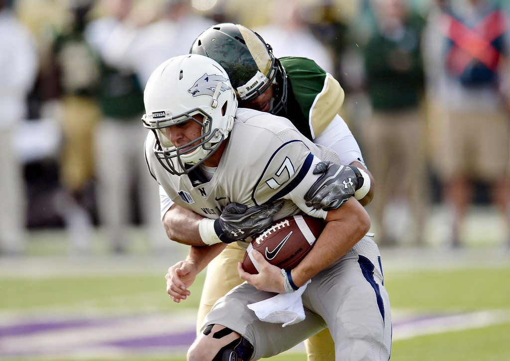 . Cory James of Colorado State University (31) sacks Cody Fajardo of University of Nevada (17) in the 1st half of the game at Hughes Stadium in Fort Collins, Colorado on November 09, 2013. CSU won 38-17. (Photo by Hyoung Chang/The Denver Post)
