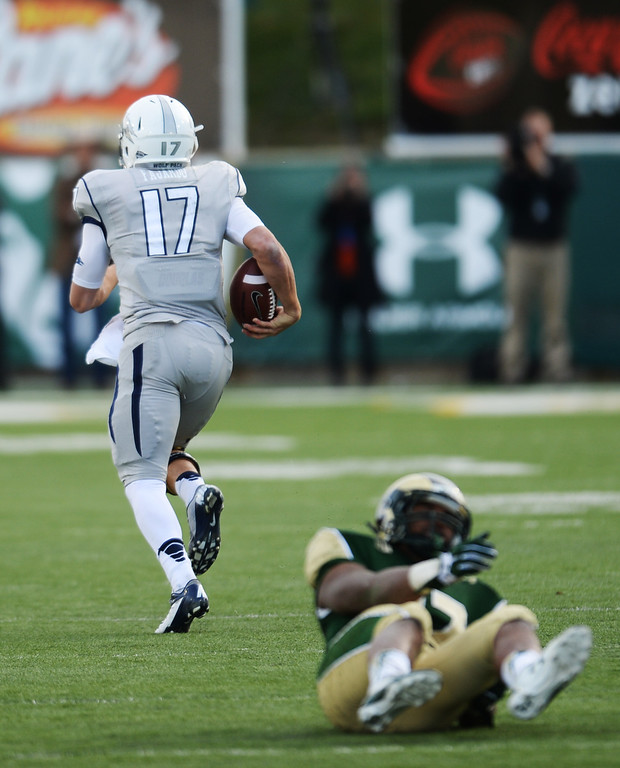 . Cody Fajardo of University of Nevada (17) rushes for a 68 yard-touchdown in the 3rd quarter of the game against Colorado State University at Hughes Stadium in Fort Collins, Colorado on November 09, 2013. CSU won 38-17. (Photo by Hyoung Chang/The Denver Post)