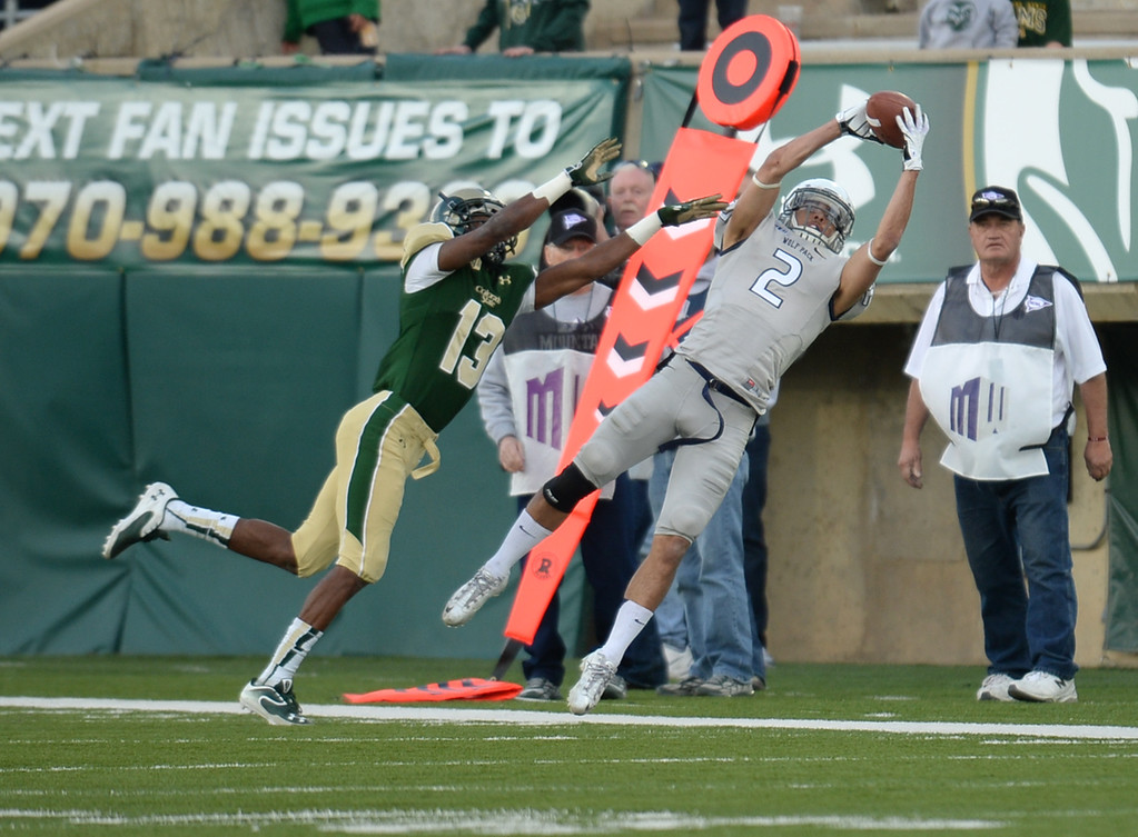 . Richy Turner of University of Nevada (2) incompletes the catch by DeAndre Elliott of Colorado State University (13) in the 4th quarter of the game at Hughes Stadium in Fort Collins, Colorado on November 09, 2013. CSU won 38-17. (Photo by Hyoung Chang/The Denver Post)