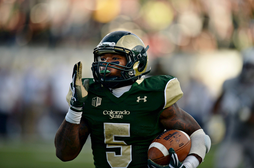 . Kapri Bibbs of Colorado State University (5) rushes for a 59-yard touchdown in the 3rd quarter of the game against University of Nevada at Hughes Stadium in Fort Collins, Colorado on November 09, 2013. CSU won 38-17. (Photo by Hyoung Chang/The Denver Post)