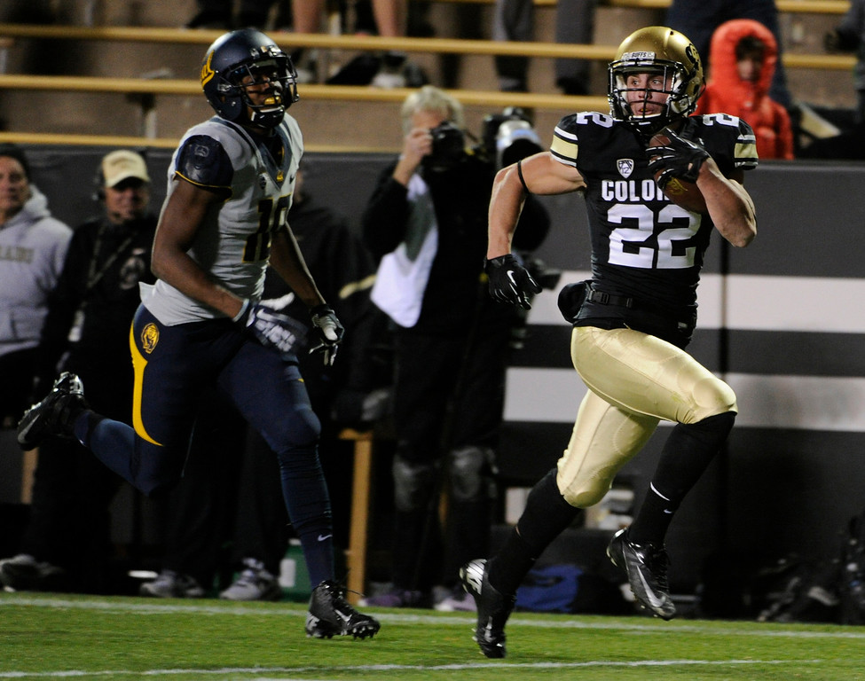 . BOULDER, CO - NOVEMBER 16: After recovering California\'s on-side kick Nelson Spruce returns the ball for a 4th quarter touch down. The University of Colorado football team takes on the University of California in the second half at Folsom Field in Boulder. (Photo by Kathryn Scott Osler/The Denver Post)