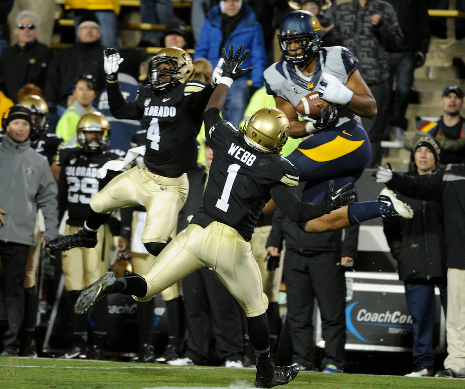 . BOULDER, CO - NOVEMBER 16: CU\'s Derrick Webb (1) and Chidobe Awuzie (4) try to stop Cal\'s Richard Rodgers from his reception. The University of Colorado football team takes on the University of California in the second half at Folsom Field in Boulder. (Photo by Kathryn Scott Osler/The Denver Post)