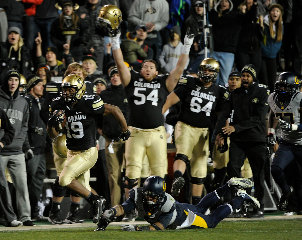 . BOULDER, CO - NOVEMBER 16: Michael Adkins II (19) outruns his opponent and makes his way up the CU sideline for a TD in the 3rd quarter. The University of Colorado football team takes on the University of California in the second half at Folsom Field in Boulder. (Photo by Kathryn Scott Osler/The Denver Post)