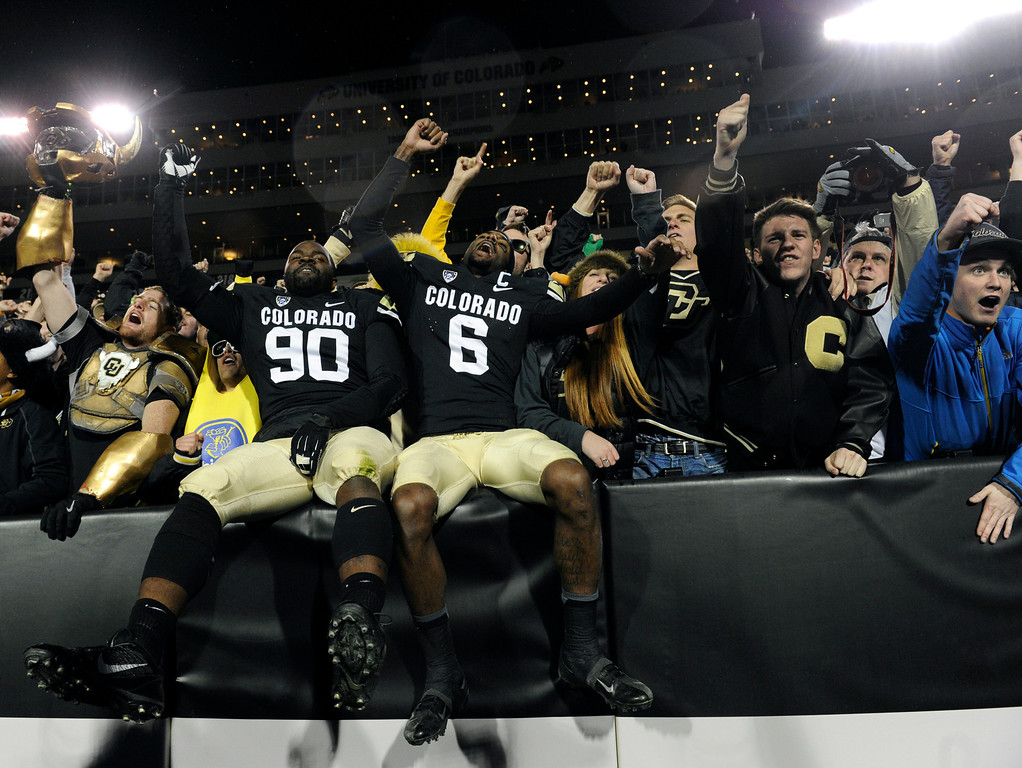 . BOULDER, CO - NOVEMBER 16: Paul Richardson (6) and De\'Jon Wilson (90) join the student section after the win in singing the CU fight song. The University of Colorado football team takes on the University of California in the second half at Folsom Field in Boulder. (Photo by Kathryn Scott Osler/The Denver Post)
