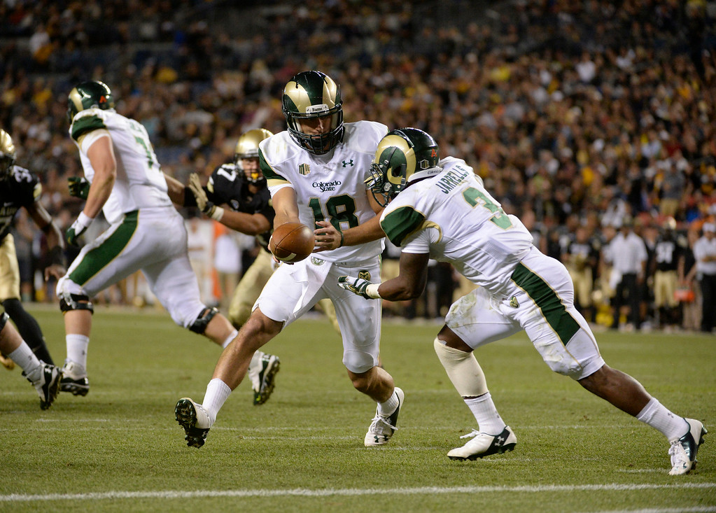 . DENVER, CO. - AUGUST 29: Colorado State QB, Garrett Grayson hands off to RB, Treyous Jarrells,  against the Colorado University  in the third quarter at the Rocky Mountain Showdown at Sports Authority Field at Mile High Friday evening, August 29, 2014. (Photo By Andy Cross / The Denver Post)