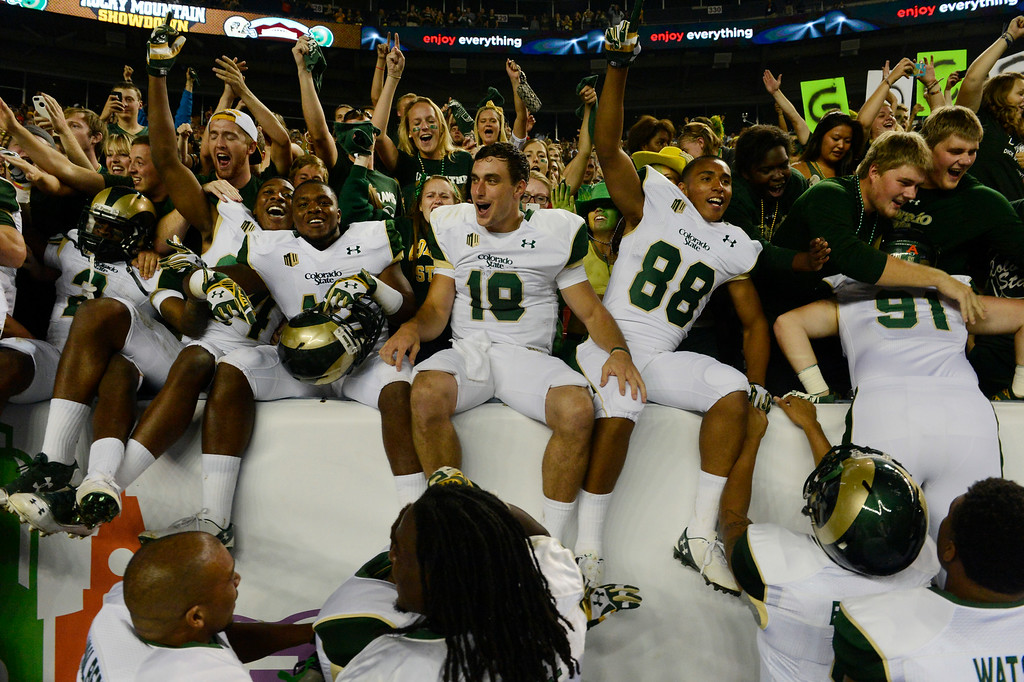 . DENVER, CO. - AUGUST 29:  The Colorado State Rams football lead by QB, Garrett Grayson, #18, celebrate with the fans after defeating Colorado University 31-17 at the Rocky Mountain Showdown at Sports Authority Field at Mile High Friday evening, August 29, 2014. (Photo By Andy Cross / The Denver Post)