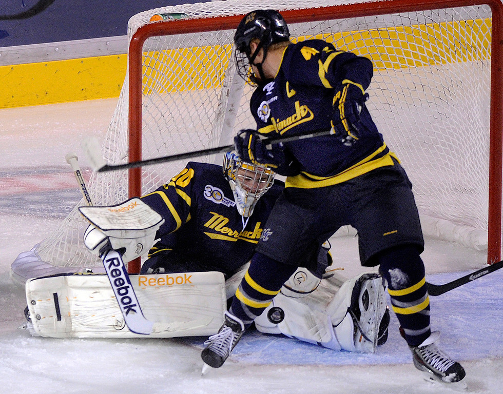 . DENVER, CO. - OCTOBER 11: Merrimack goaltender Sam Marotta (30) made a save in the first period. The University of Denver men\'s hockey team hosted Merrimack at Magness Arena Friday night, October 11, 2013. Photo By Karl Gehring/The Denver Post