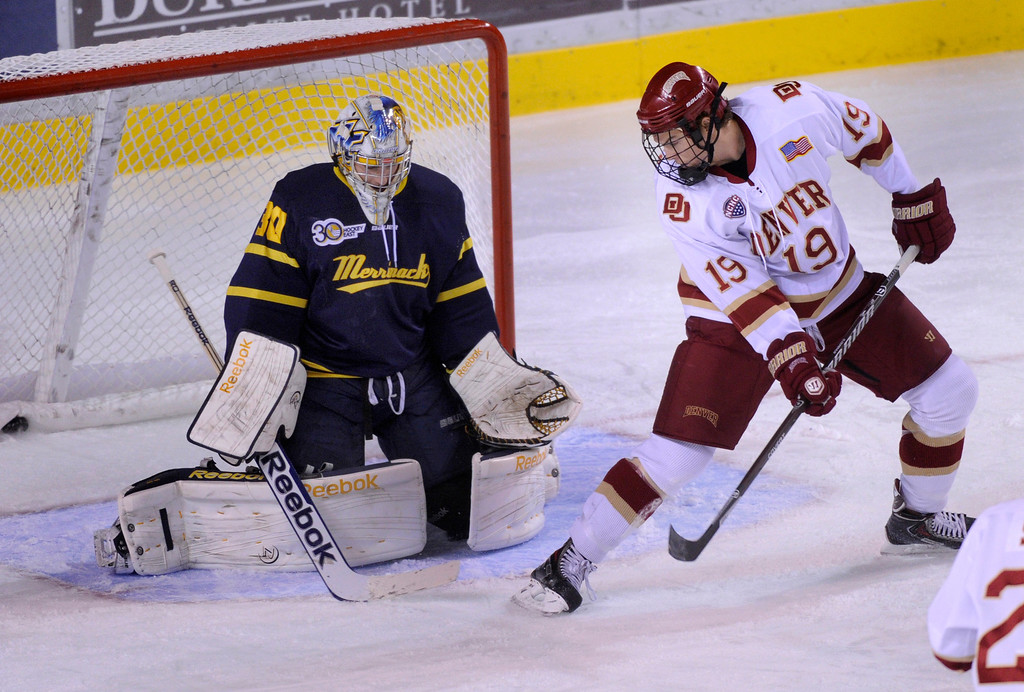 . DENVER, CO. - OCTOBER 11: Denver center Daniel Doremus (19) redirected the puck past Merrimack goalie Sam Marotta (30) for a goal in the first period. Sophomore Nolan Zajac got the assist. The University of Denver men\'s hockey team hosted Merrimack at Magness Arena Friday night, October 11, 2013. Photo By Karl Gehring/The Denver Post