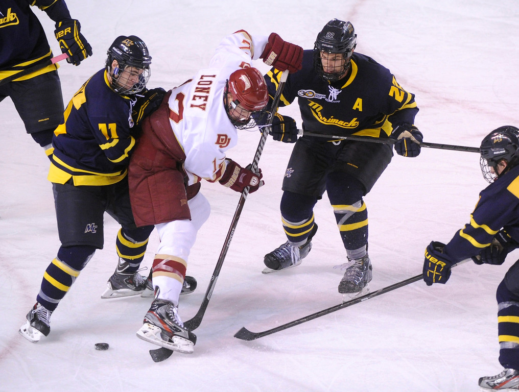 . DENVER, CO. - OCTOBER 11: merrimack wing Connor Toomey (11) pushed Denver\'s Ty Loney (12) off the puck in the third period. The University of Denver men\'s hockey team defeated Merrimack 1-0 at Magness Arena Friday night, October 11, 2013. Photo By Karl Gehring/The Denver Post