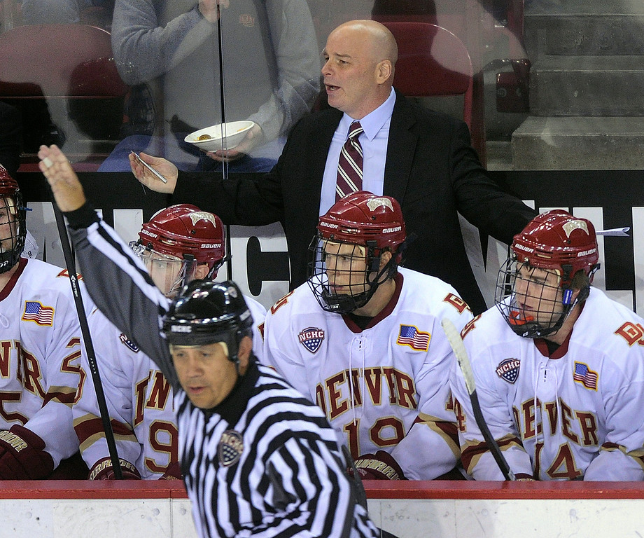 . DENVER, CO. - OCTOBER 11: Denver coach Jim Montgomery talked to his players after the Pioneers took a penalty in the first period. The University of Denver men\'s hockey team hosted Merrimack at Magness Arena Friday night, October 11, 2013. Photo By Karl Gehring/The Denver Post