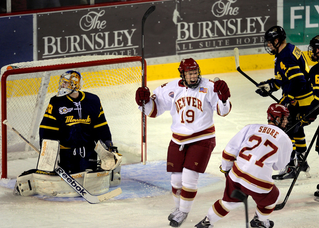. DENVER, CO. - OCTOBER 11: Denver center Daniel Doremus (19) celebrated his goal past Merrimack goalie Sam Marotta (30) in the first period. The University of Denver men\'s hockey team hosted Merrimack at Magness Arena Friday night, October 11, 2013. Photo By Karl Gehring/The Denver Post