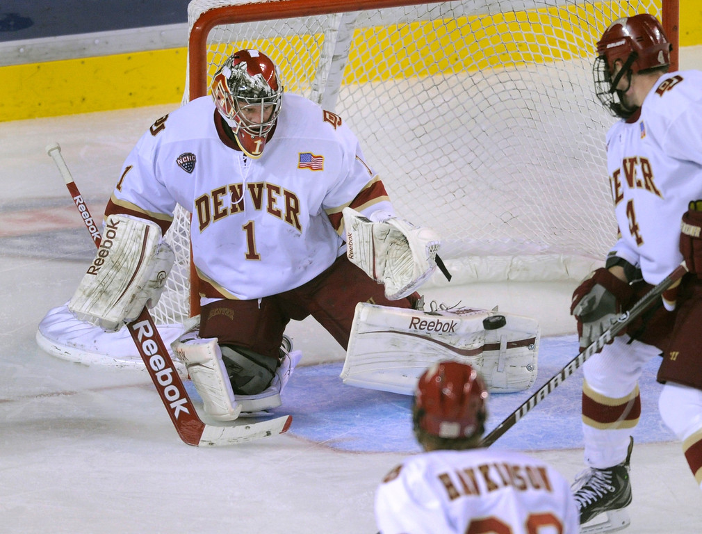 . DENVER, CO. - OCTOBER 11: Denver goaltender Sam Brittain (1) made a save in the second period. The University of Denver men\'s hockey team hosted Merrimack at Magness Arena Friday night, October 11, 2013. Photo By Karl Gehring/The Denver Post