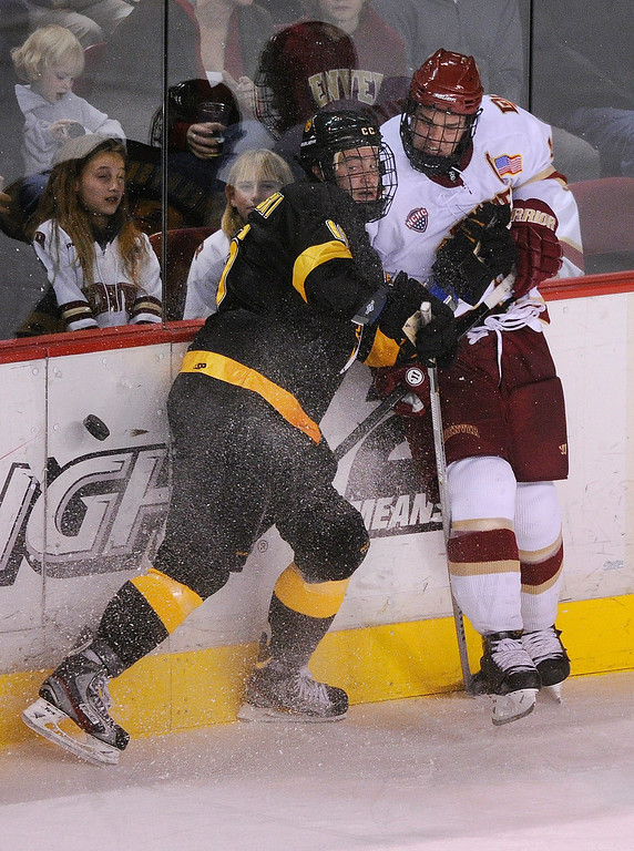 . Tigers wing Alexander Krushelnyski (16) fought for the puck with Denver defensman David Makowski (10) in the third period. The University of Denver hockey team defeated Colorado College 2-1 at Magness Arena Saturday night, November 9, 2013. Photo By Karl Gehring/The Denver Post