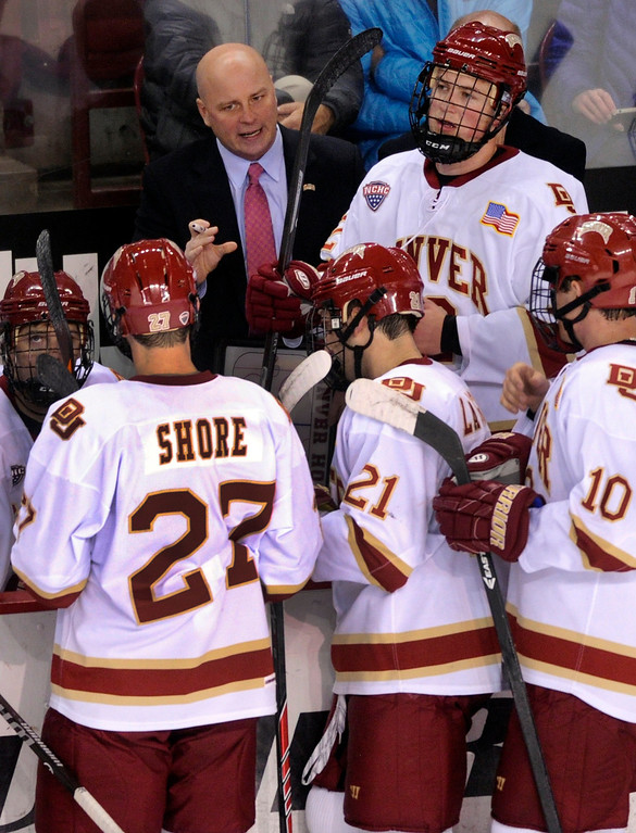 . Denver coach Jim Montgomery talked to the team in the first period. The University of Denver hockey team hosted Colorado College at Magness Arena Saturday night, November 9, 2013. Photo By Karl Gehring/The Denver Post