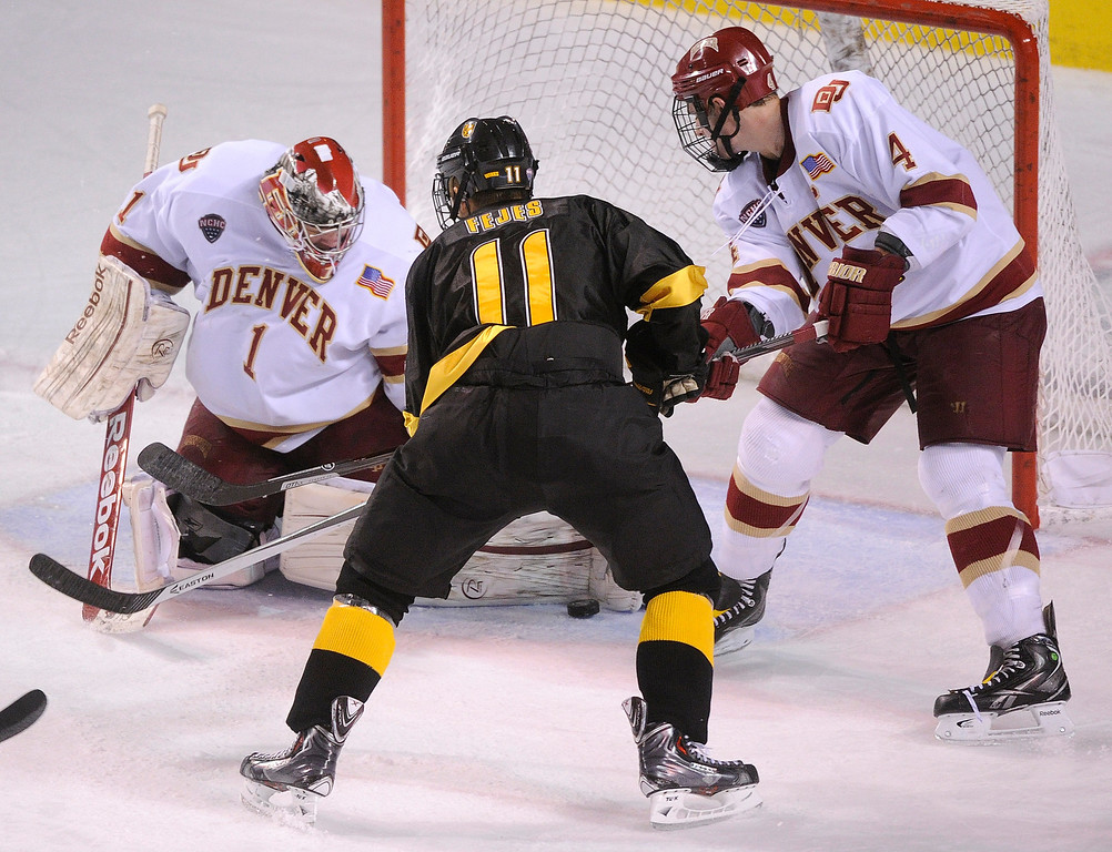 . Denver goaltender Sam Brittain made a save in the their period as CC wing Hunter Fejes looked for a second chance at the puck. The University of Denver hockey team defeated Colorado College 2-1 at Magness Arena Saturday night, November 9, 2013. Photo By Karl Gehring/The Denver Post