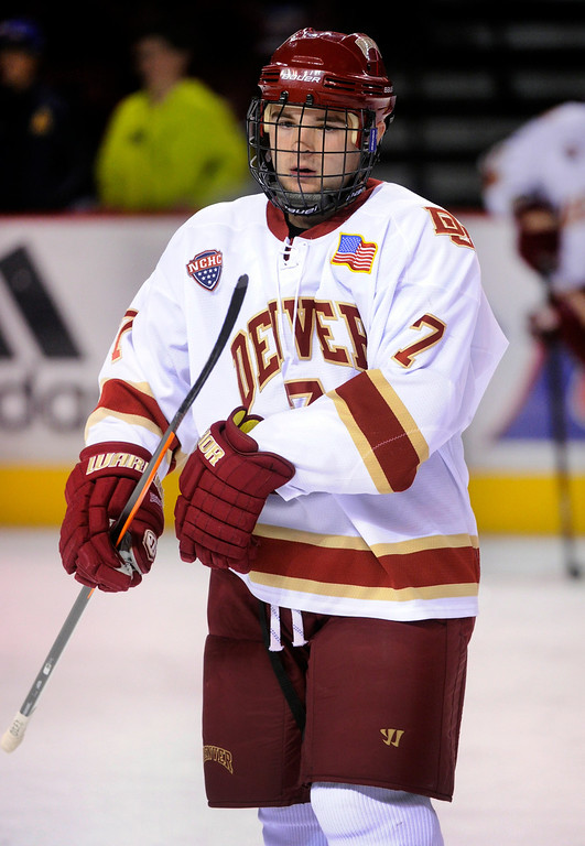 . Denver defenseman Will Butcher skated before the game Saturday night. The University of Denver hockey team hosted Colorado College at Magness Arena Saturday night, November 9, 2013. Photo By Karl Gehring/The Denver Post