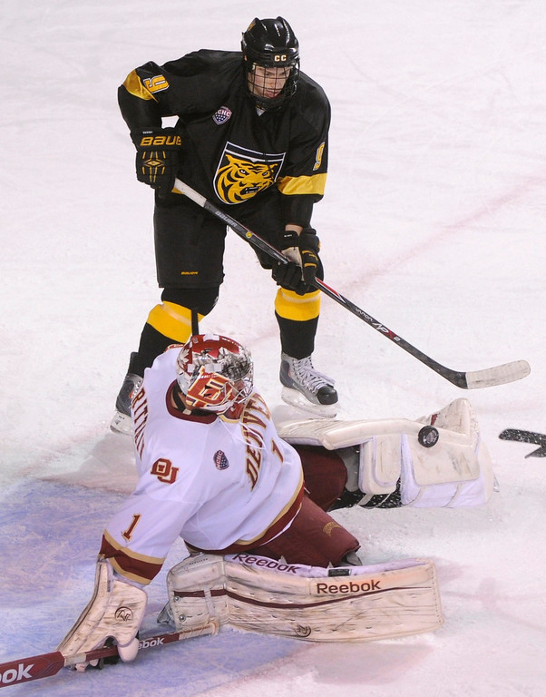 . Denver goaltender Sam Brittain made a save in the second period. The University of Denver hockey team hosted Colorado College at Magness Arena Saturday night, November 9, 2013. Photo By Karl Gehring/The Denver Post