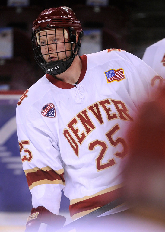 . Denver right wing Matt Tabrum skated before the game. The University of Denver hockey team hosted Colorado College at Magness Arena Saturday night, November 9, 2013. Photo By Karl Gehring/The Denver Post