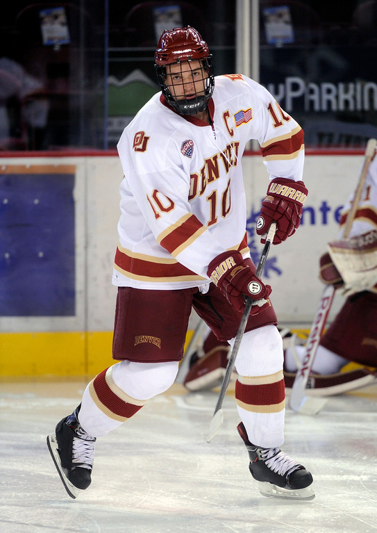 . Denver defenseman David Makowski skated before the game. The University of Denver hockey team hosted Colorado College at Magness Arena Saturday night, November 9, 2013. Photo By Karl Gehring/The Denver Post