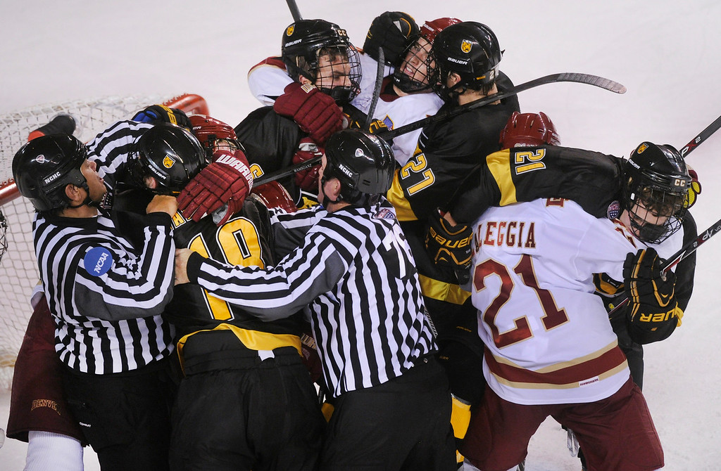 . Tempers boiled over in front of the Denver net in the second period. The incident left three players in each penalty box. The University of Denver hockey team hosted Colorado College at Magness Arena Saturday night, November 9, 2013. Photo By Karl Gehring/The Denver Post