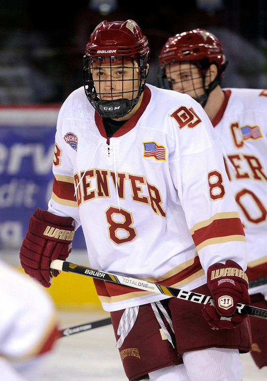 . Denver wing Trevor Moore skated before the game. The University of Denver hockey team hosted Colorado College at Magness Arena Saturday night, November 9, 2013. Photo By Karl Gehring/The Denver Post