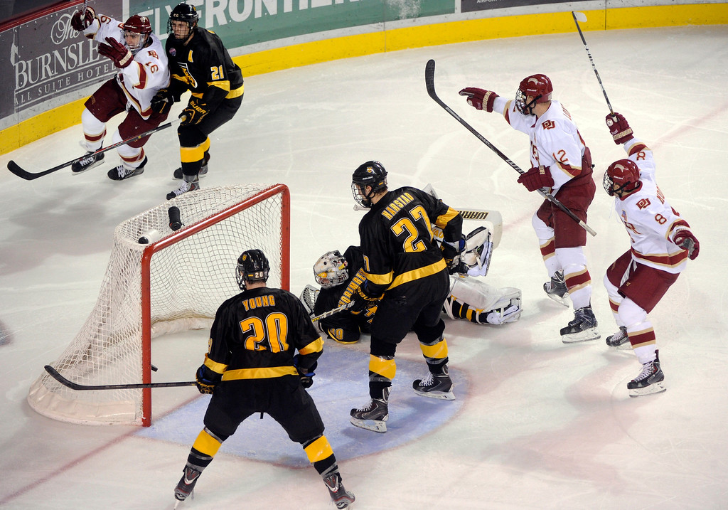 . Denver left wing Zac Laraza (16) celebrated after he lifted a shot past Tigers goaltender Josh Thorimbert (39) in the third period. The University of Denver hockey team defeated Colorado College 2-1 at Magness Arena Saturday night, November 9, 2013. Photo By Karl Gehring/The Denver Post