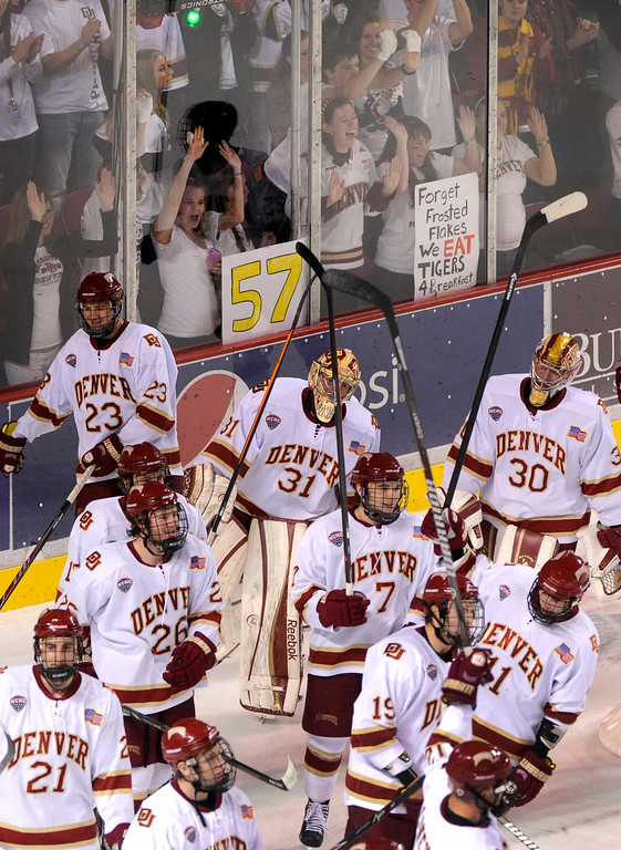 . The Pioneers skated past the DU student section after the win Saturday night. The University of Denver hockey team defeated Colorado College 2-1 at Magness Arena Saturday night, November 9, 2013. Photo By Karl Gehring/The Denver Post
