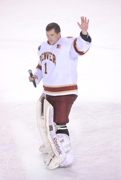 . DENVER, CO - MARCH 7:nDenver senior Sam Brittain waved to fans as each of the senior was introduced after the game. The University of Denver hockey team lost to Miami of Ohio 2-1 at Magness Arena Saturday night, March 8, 2014 in Denver, Colorado. It was the last home game of the regular season. (Photo by Karl Gehring/The Denver Post)