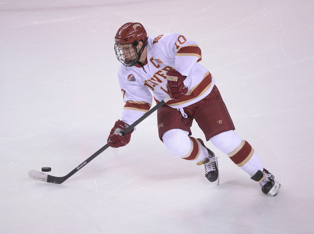 . DENVER, CO - MARCH 7: Denver defenseman David Makowski controlled the puck in the first period. The University of Denver hockey team hosted Miami of Ohio at Magness Arena Saturday night, March 8, 2014 in Denver, Colorado. (Photo by Karl Gehring/The Denver Post)