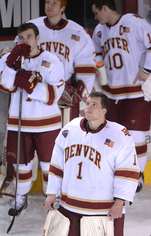 . DENVER, CO - MARCH 7: Senior Sam Brittain watched a video tribute to his fours years as the Pioneers goalie after the game. The University of Denver hockey team lost to Miami of Ohio 2-1 at Magness Arena Saturday night, March 8, 2014 in Denver, Colorado. It was the last home game of the regular season. (Photo by Karl Gehring/The Denver Post)