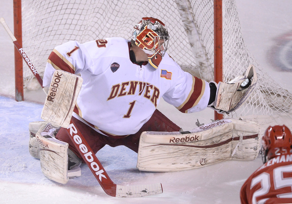 . DENVER, CO - MARCH 7: Denver senior goalie Sam Brittain made a save in the third period. The University of Denver hockey team hosted Miami of Ohio at Magness Arena Saturday night, March 8, 2014 in Denver, Colorado. (Photo by Karl Gehring/The Denver Post)