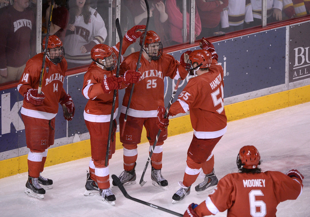 . DENVER, CO - MARCH 7: Redhawks left wing Blake Coleman (25) was surrounded by teammates after his second period goal. The University of Denver hockey team hosted Miami of Ohio at Magness Arena Saturday night, March 8, 2014 in Denver, Colorado. (Photo by Karl Gehring/The Denver Post)