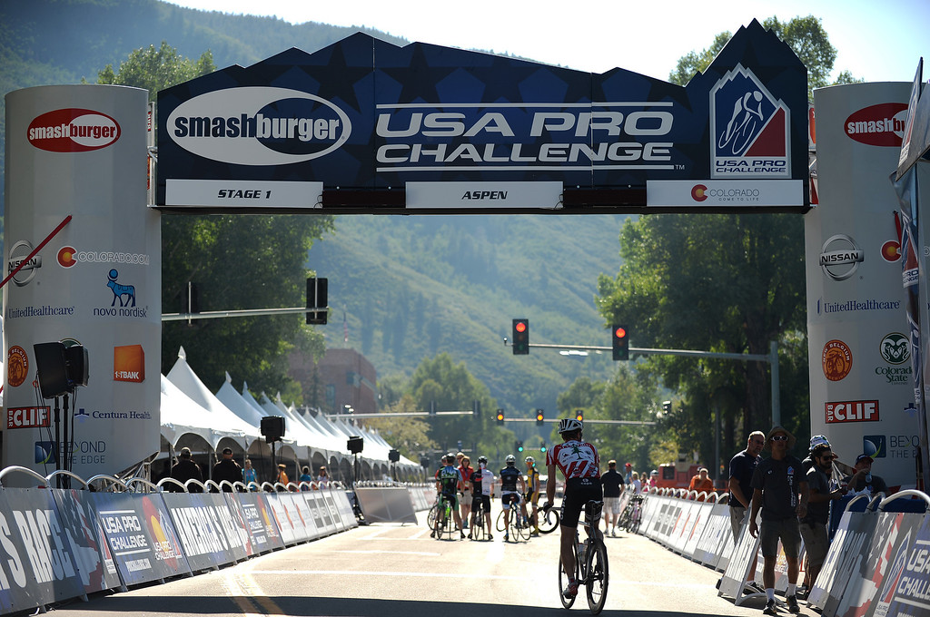 . Cyclists take a look around near the starting point for  the first stage of 2013 USA Pro Challenge  in Aspen.  (Photo By Hyoung Chang/The Denver Post)