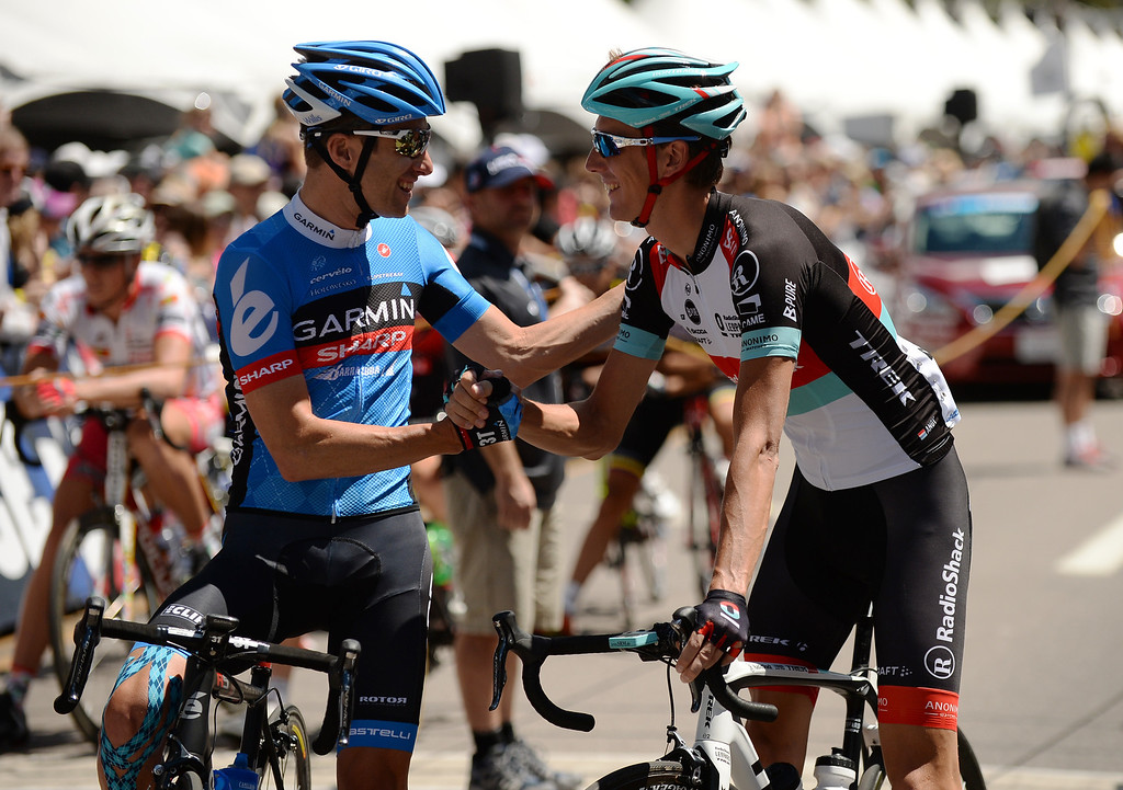 . Christian Vandevelde of team Garmin, left, and Andy Schleck of RadioShack greet each other during opening day of 2013 USA Pro Challenge race in Aspen, Colorado.  (Photo By Hyoung Chang/The Denver Post)