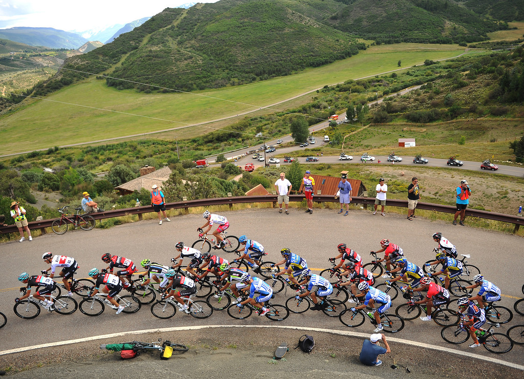 . The pack of cyclists climb a hill on the course to  Snowmass during first stage of 2013 USA Pro Challenge race in Aspen. Photo By Hyoung Chang/The Denver Post)