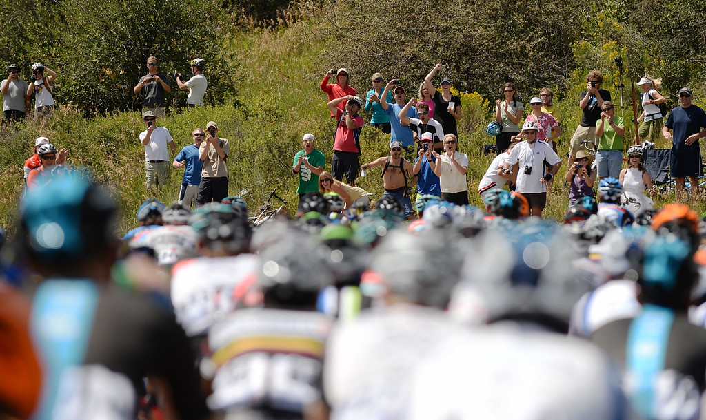 . Fans cheer the riders during the first stage of 2013 USA Pro Challenge in Aspen, Colorado. (Photo By Hyoung Chang/The Denver Post)
