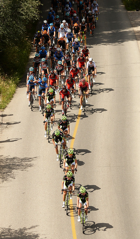 . The Cannondale Pro Cycling team leads the pack during the first stage of 2013 USA Pro Challenge race. (Photo By Hyoung Chang/The Denver Post)