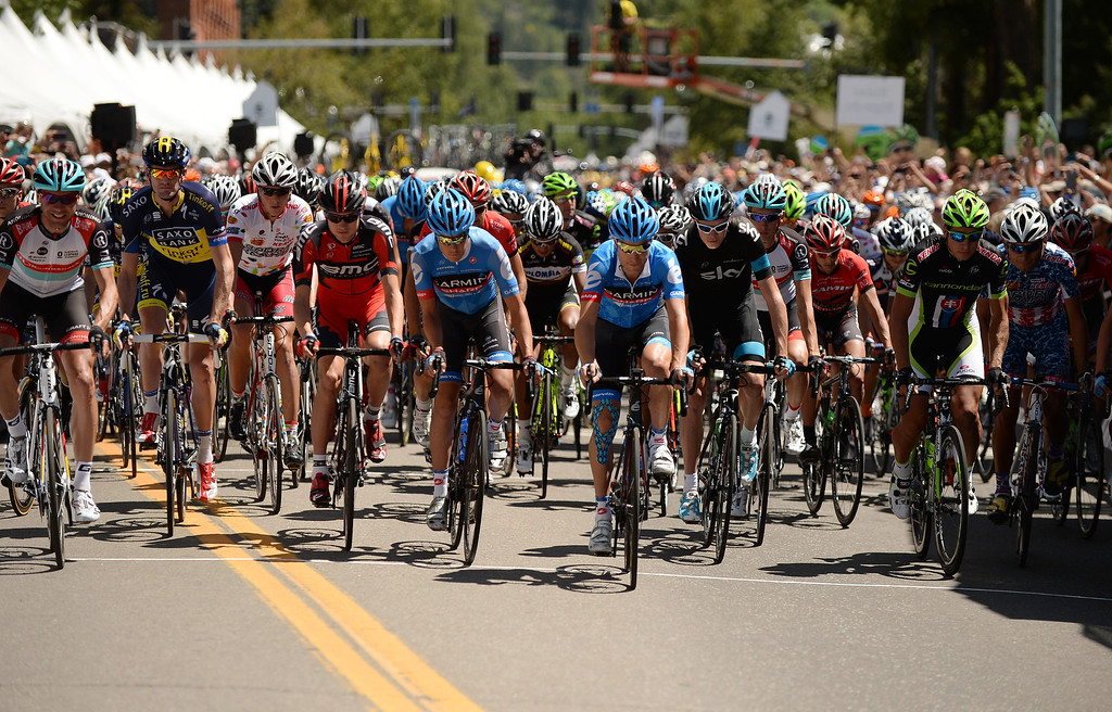 . The pack of cyclists head to Snowmass from downtown Aspen during the first stage of the 2013 USA Pro Challenge race. (Photo By Hyoung Chang/The Denver Post)