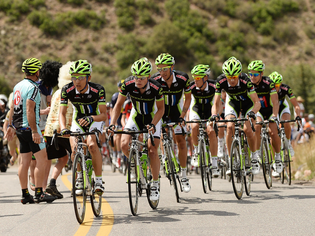 . The Cannondale Pro Cycling team helps Peter Sagan during a climb on day one of the  2013 USA Pro Challenge race in Aspen, Colorado.   (Photo By Hyoung Chang/The Denver Post)