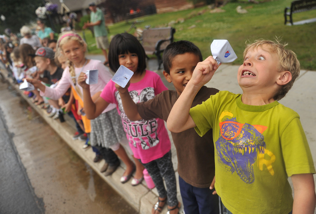 . STEAMBOAT SPRINGS, CO - August 21: Kremmling Elementary School second graders cheer the cyclists during 106.9 mi third stage of 2013 USA Pro Challenge race from Breckenridge to Steamboat Springs. Steamboat Springs, Colorado. August 21, 2013. (Photo By Hyoung Chang/The Denver Post)