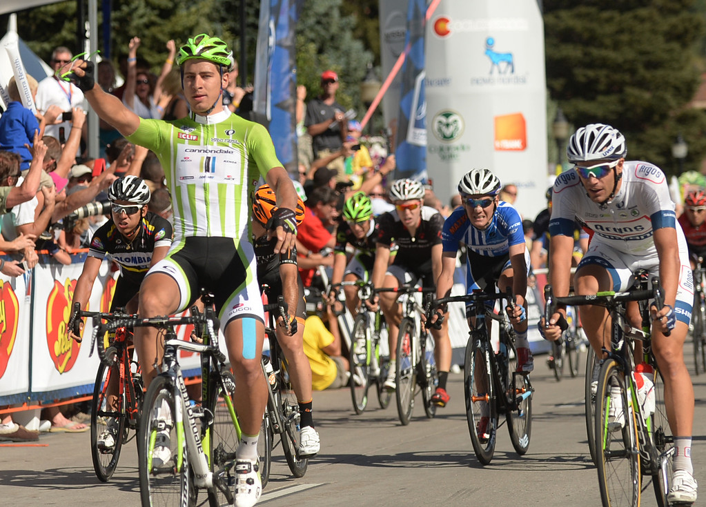 . STEAMBOAT SPRINGS, CO - August 21: Peter Sagan of Cannondale Pro Cycling Team, left, won the 106.9 mi third stage of 2013 USA Pro Challenge race from Breckenridge to Steamboat Springs. Steamboat Springs, Colorado. August 21, 2013. (Photo By Hyoung Chang/The Denver Post)
