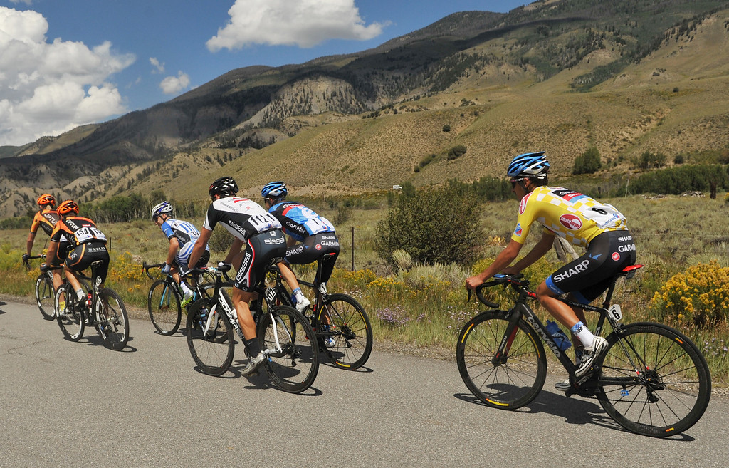 . STEAMBOAT SPRINGS, CO - August 21: Lachlan Morton of Team Garmin-Sharp (#6), right, is heading to Rabbit Ear Pass (9430 ft) during 106.9 mi third stage of 2013 USA Pro Challenge race from Breckenridge to Steamboat Springs. Steamboat Springs, Colorado. August 21, 2013. Morton defended Yellow Jersey in this stage. (Photo By Hyoung Chang/The Denver Post)