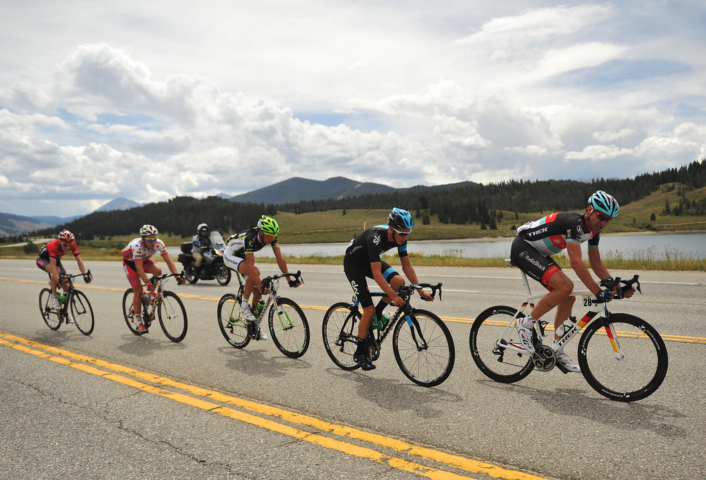 . STEAMBOAT SPRINGS, CO - August 21: Jens Voigt of RadioShack (#28) lead the group by Dillon Reservoir during 106.9 mi third stage of 2013 USA Pro Challenge race from Breckenridge to Steamboat Springs. Steamboat Springs, Colorado. August 21, 2013. (Photo By Hyoung Chang/The Denver Post)