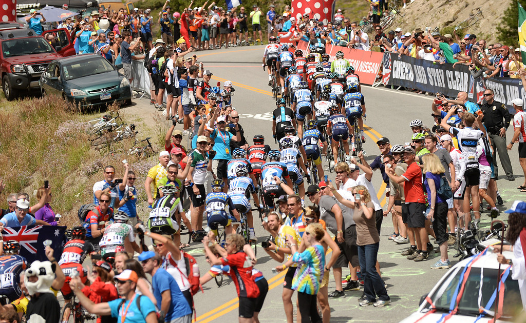 . STEAMBOAT SPRINGS, CO - August 21: Riders in the peloton are climbing Swan Mountain (9507 ft) during 106.9 mi third stage of 2013 USA Pro Challenge race from Breckenridge to Steamboat Springs. Steamboat Springs, Colorado. August 21, 2013. (Photo By Hyoung Chang/The Denver Post)