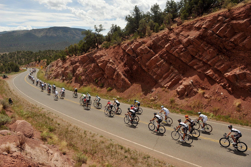 . The pack heads to Oak Creek during the 103.7-mile fourth stage of 2013 USA Pro Challenge race from Steamboat Springs to Beaver Creek, Colorado. August 22, 2013. (Photo by Hyoung Chang/The Denver Post)