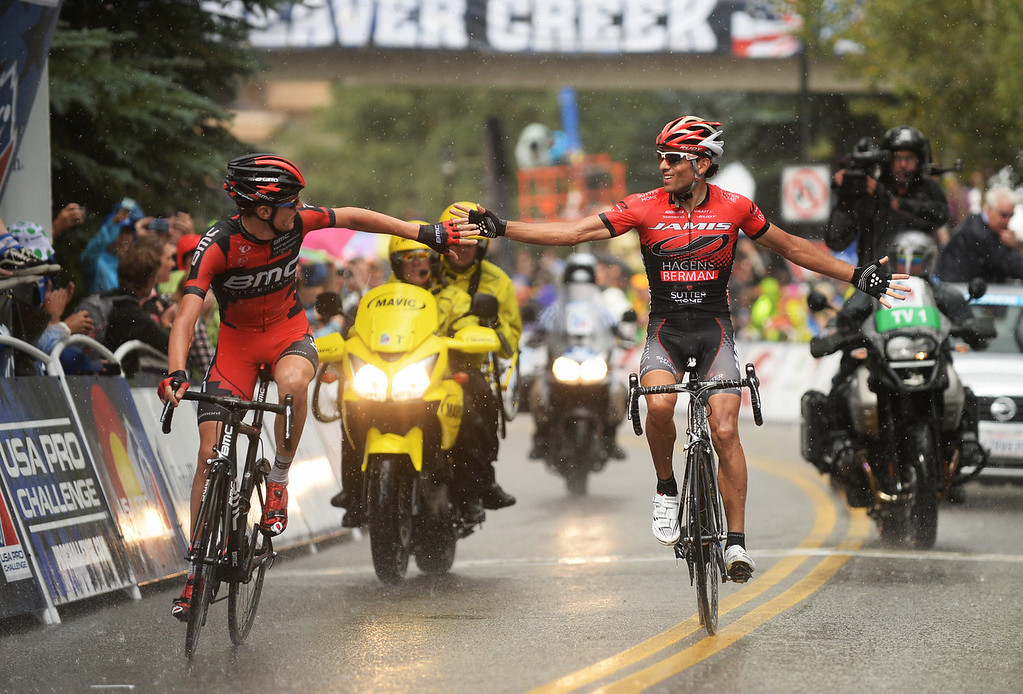 . Janier Alexis Acevedo Calle of Jamis-Hagens Berman, right, and Tejay van Garderen of BMC Racing Team celebrate finishing the 103.7-mile fourth stage of 2013 USA Pro Challenge race from Steamboat Springs to Beaver Creek, Colorado.  Janier Alexis Acevedo Calle won the stage and Tejay van Garderen finished 2nd and became leader of the race. (Photo by Hyoung Chang/The Denver Post)